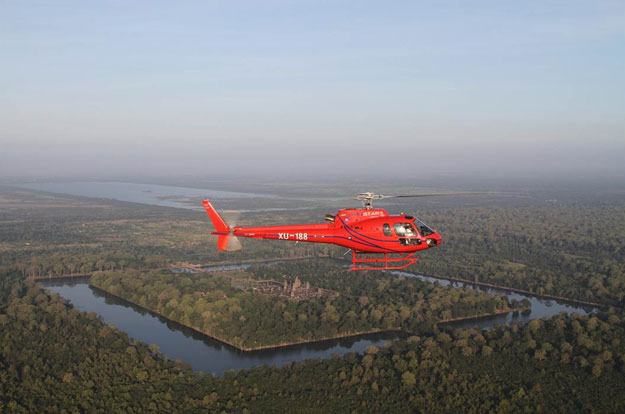 Cambodia Luxury Travel | Ker Downey | Helicopter over Angkor Wat